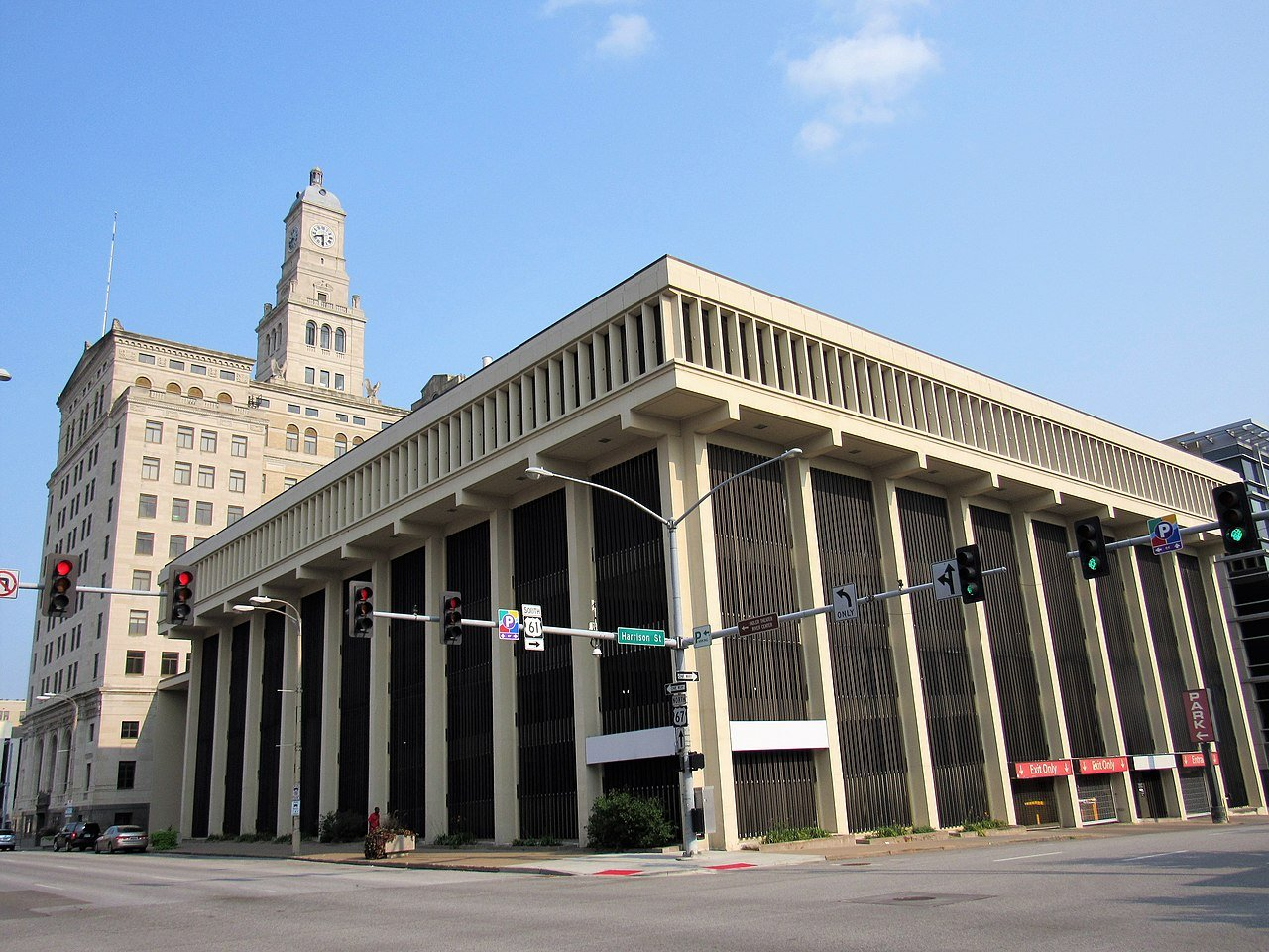 The parking structure was built in 1971 and was added to the bank building's National Register listing (as a boundary increase) in 2016.