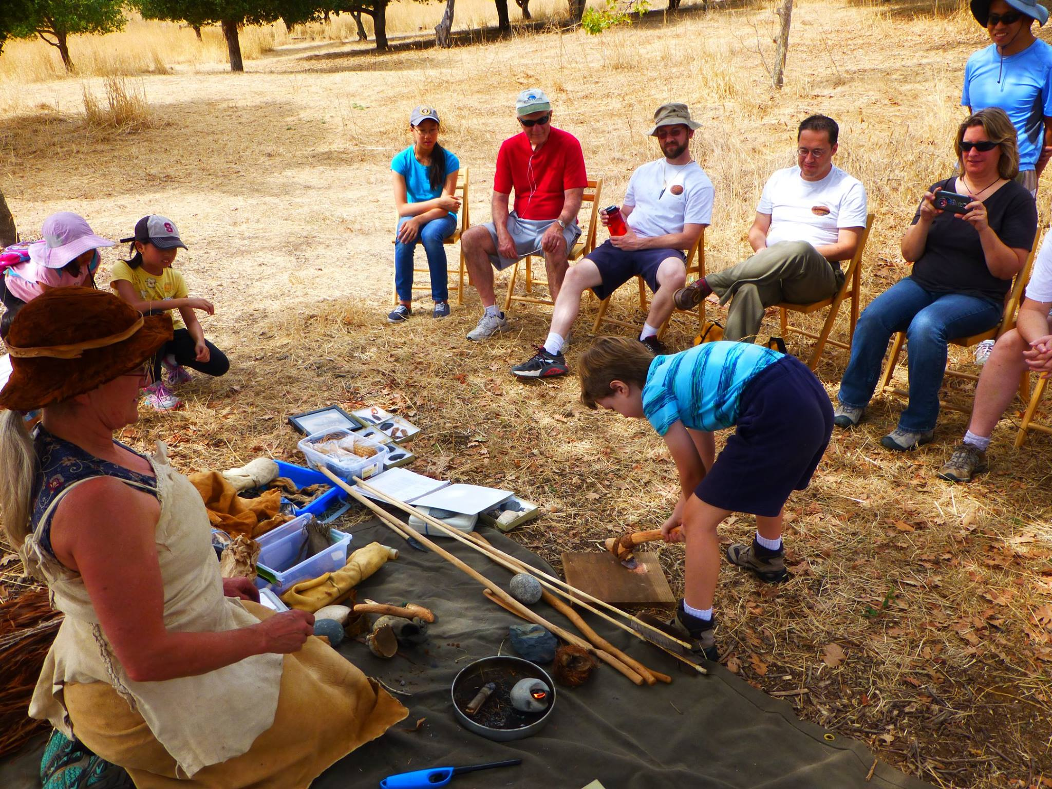 Visitors learn about Ohlone tools (Coyote Hills Facebook).