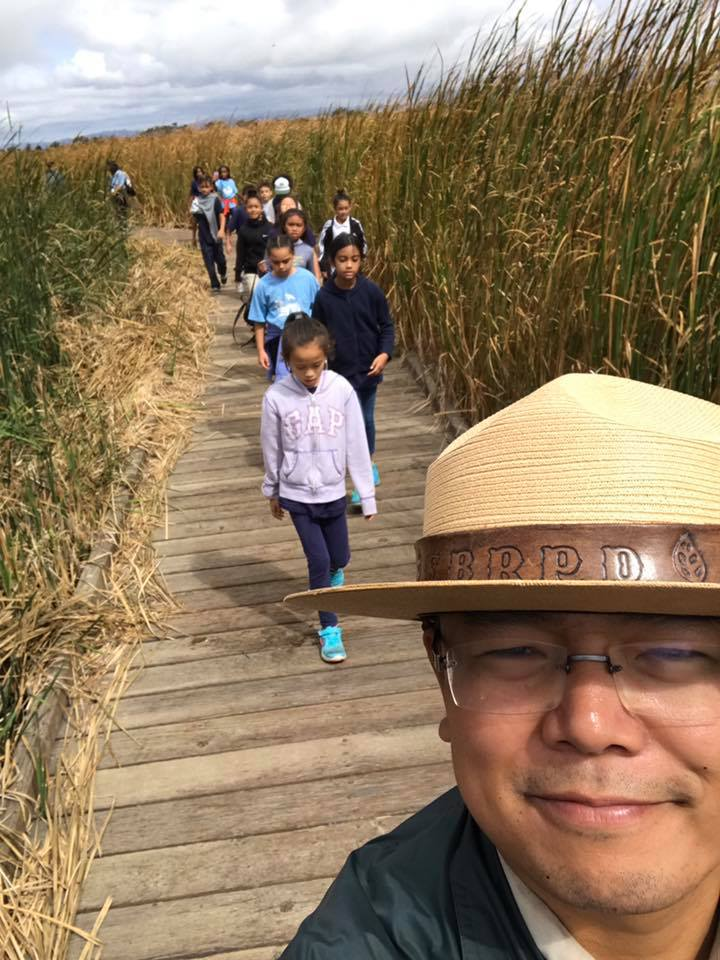 A Park ranger leads a field trip through the marsh boardwalks. Seasonal rainfall can cause the boardwalks to close intermittently (Coyote Hills Facebook).