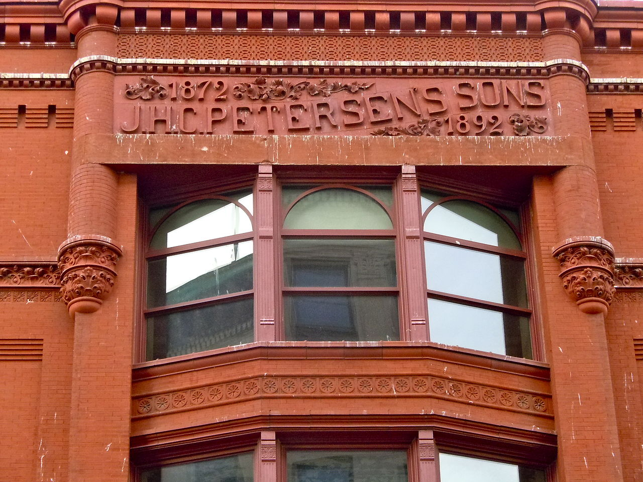 Closeup of the Petersen name on the building.