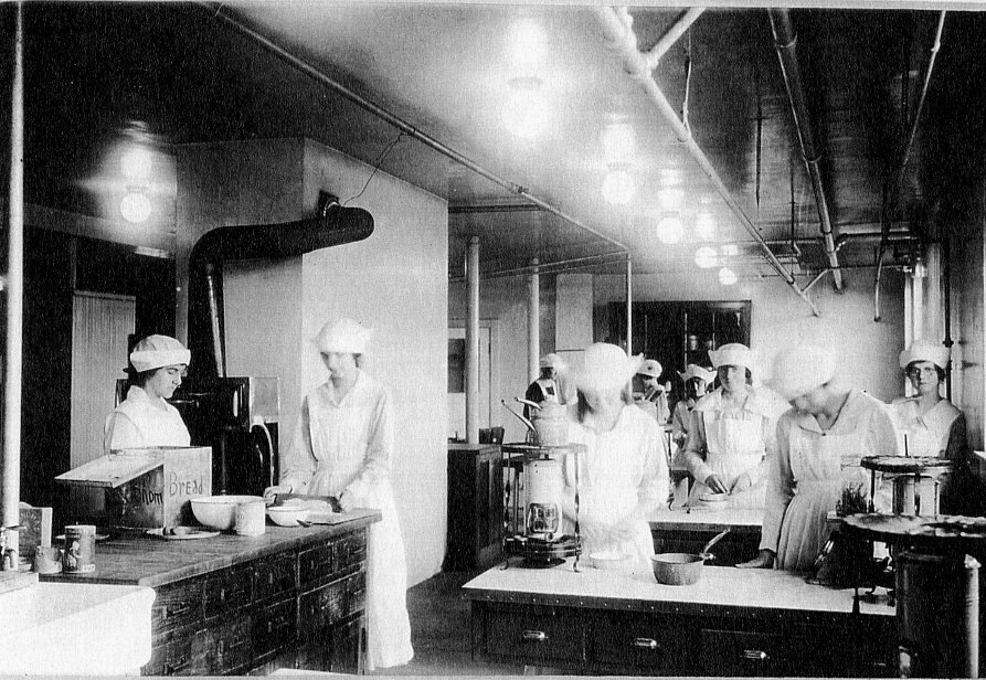 Students cook during a class in Virginia Hall's basement.