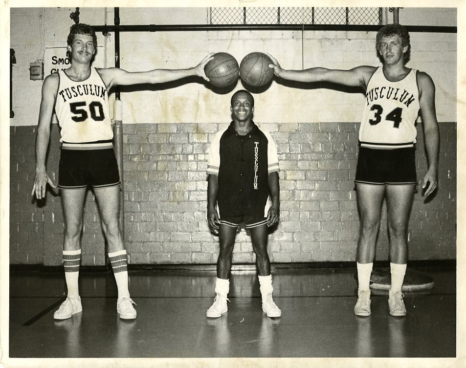 Members of the basketball team in the old gymnasium
