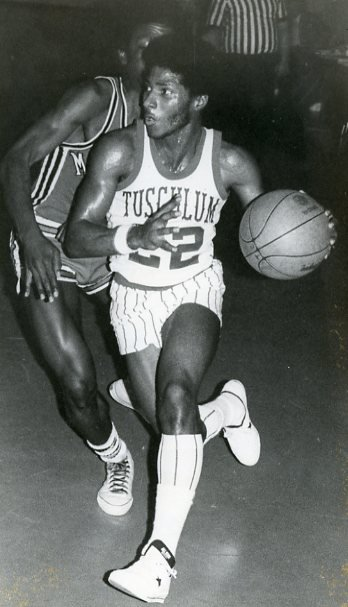 A basketball player in action in the old gymnasium