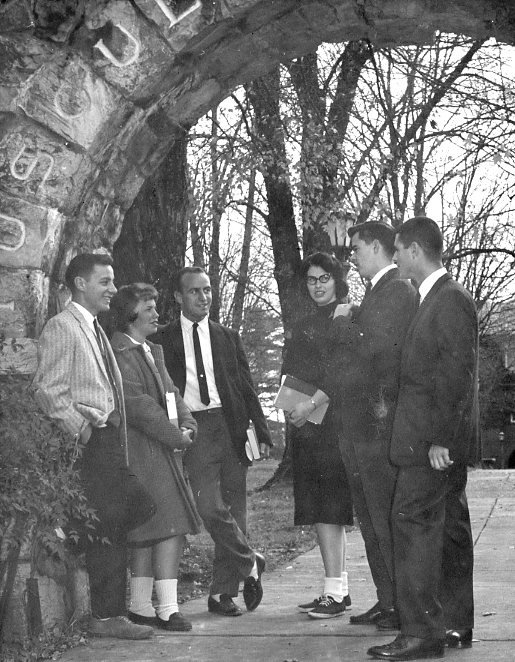 Students gather under the arch.