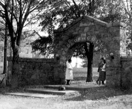 Students gathered under the arch.