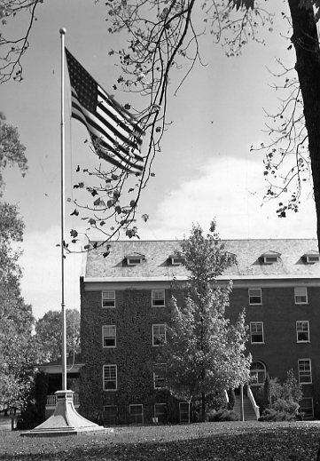 The flag pole with Virginia Hall in the background.