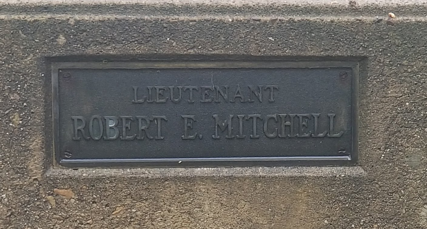 Lieutenant Robert E. Mitchell plaque as seen on the flagpole base. Mitchell was killed in the First World War October 15, 1918.