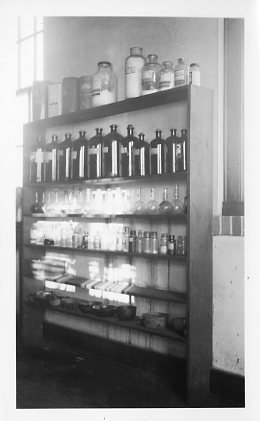 Chemical supply shelf in one of the labs in the Science Hall.