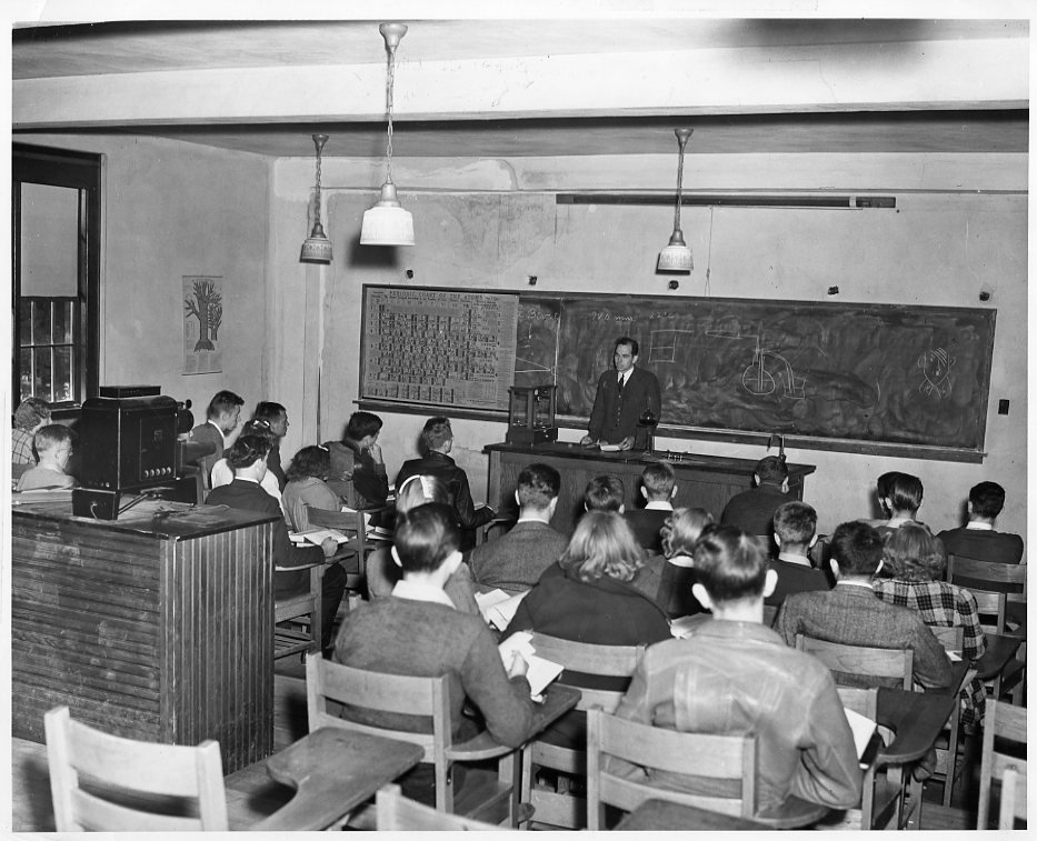 Dr. Wallace W. Stuart, Professor of Chemistry, lectures his students in the Science Hall, 1940.