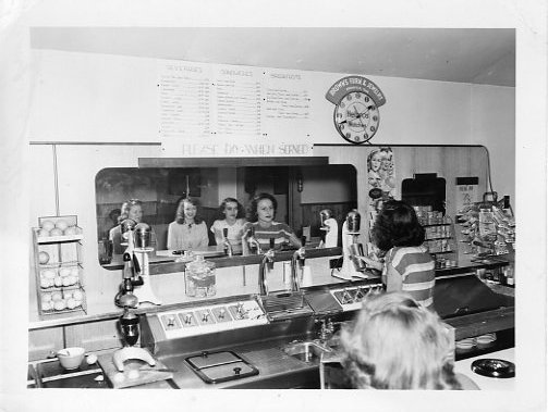 Students ordering food in old student union building.