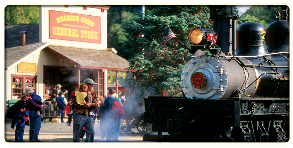 One of Roaring Camp's steam locomotives with the general store in background (RoaringCamp.com).