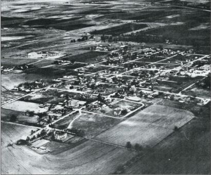1965 aerial photo pf Pflugerville.  School and Rock Gym are on the North side of West Pecan Street.