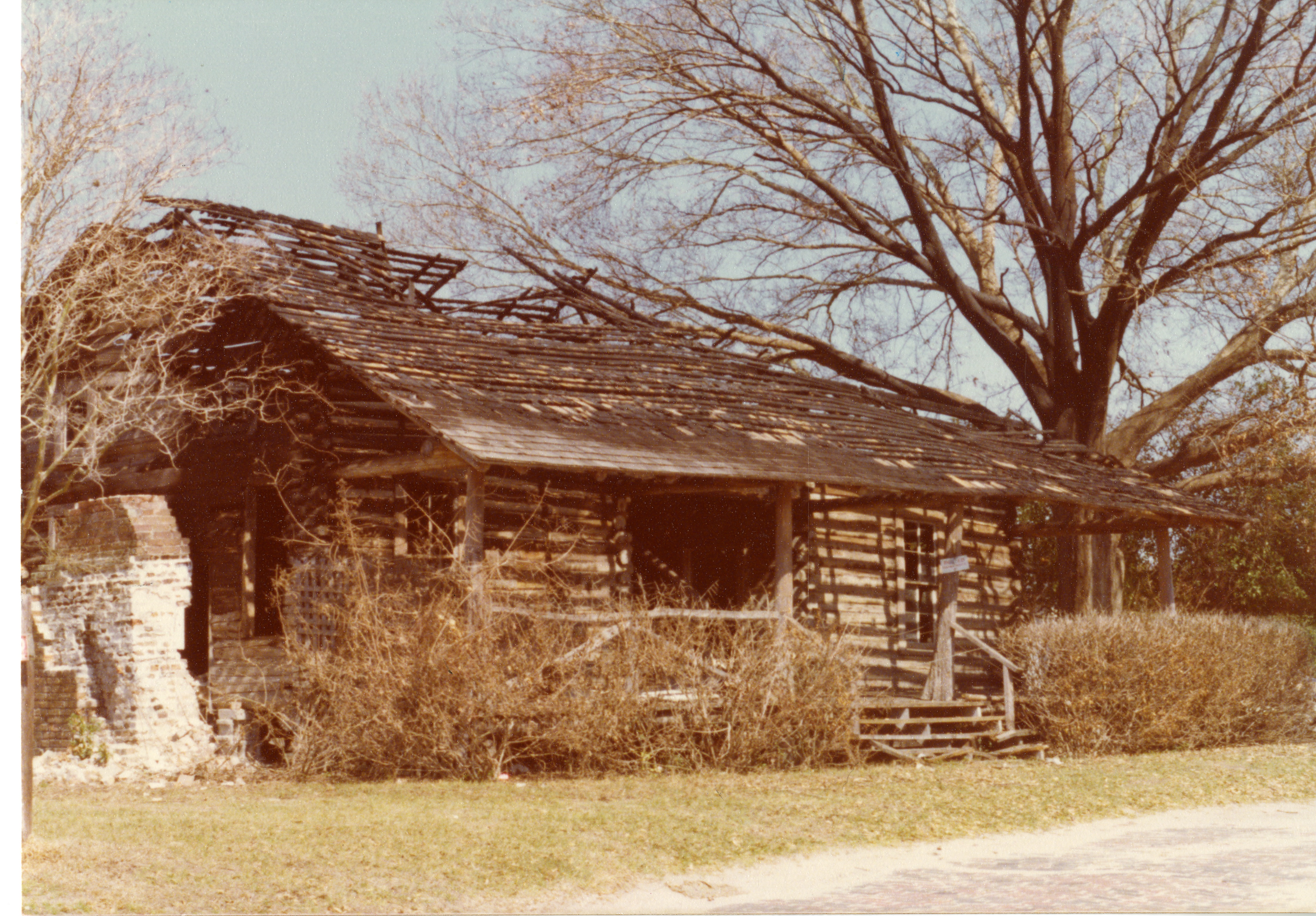 McMullen Coachman Log Cabin after damage from arson, Clearwater, Florida, 1976.