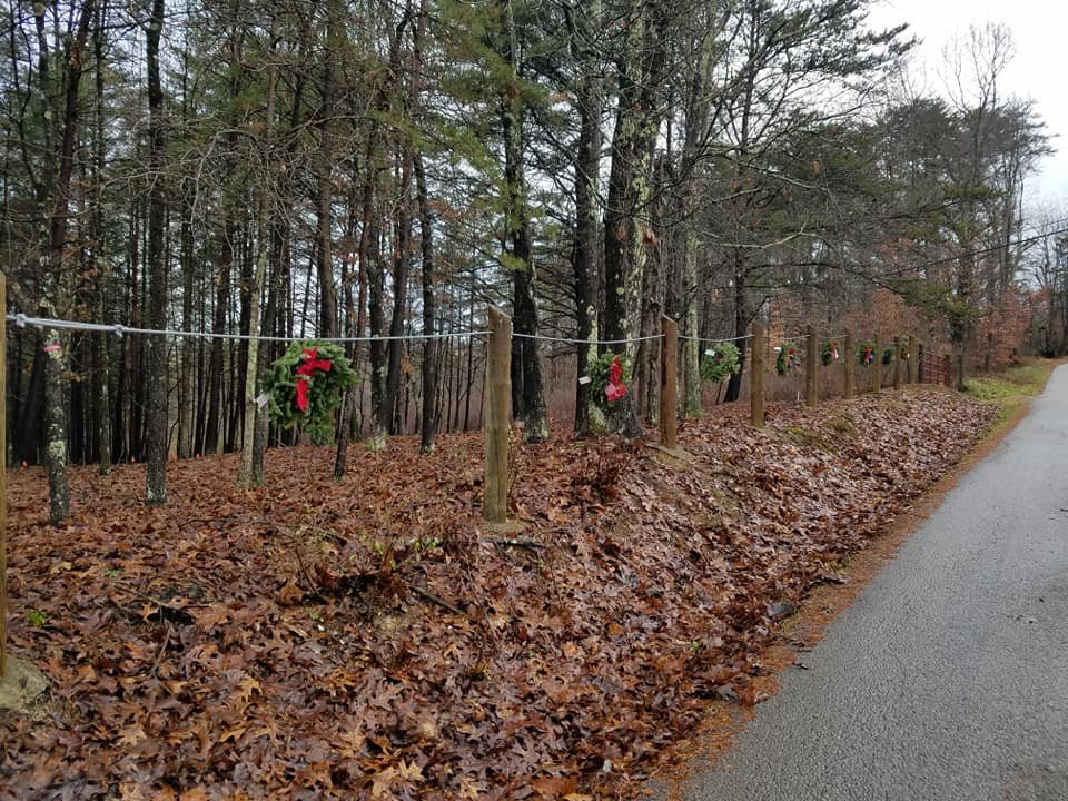 An image of the cemetery decorated with wreaths.