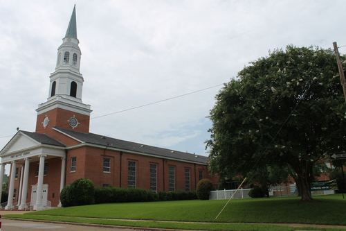 The main entrance, steeple, and sanctuary.