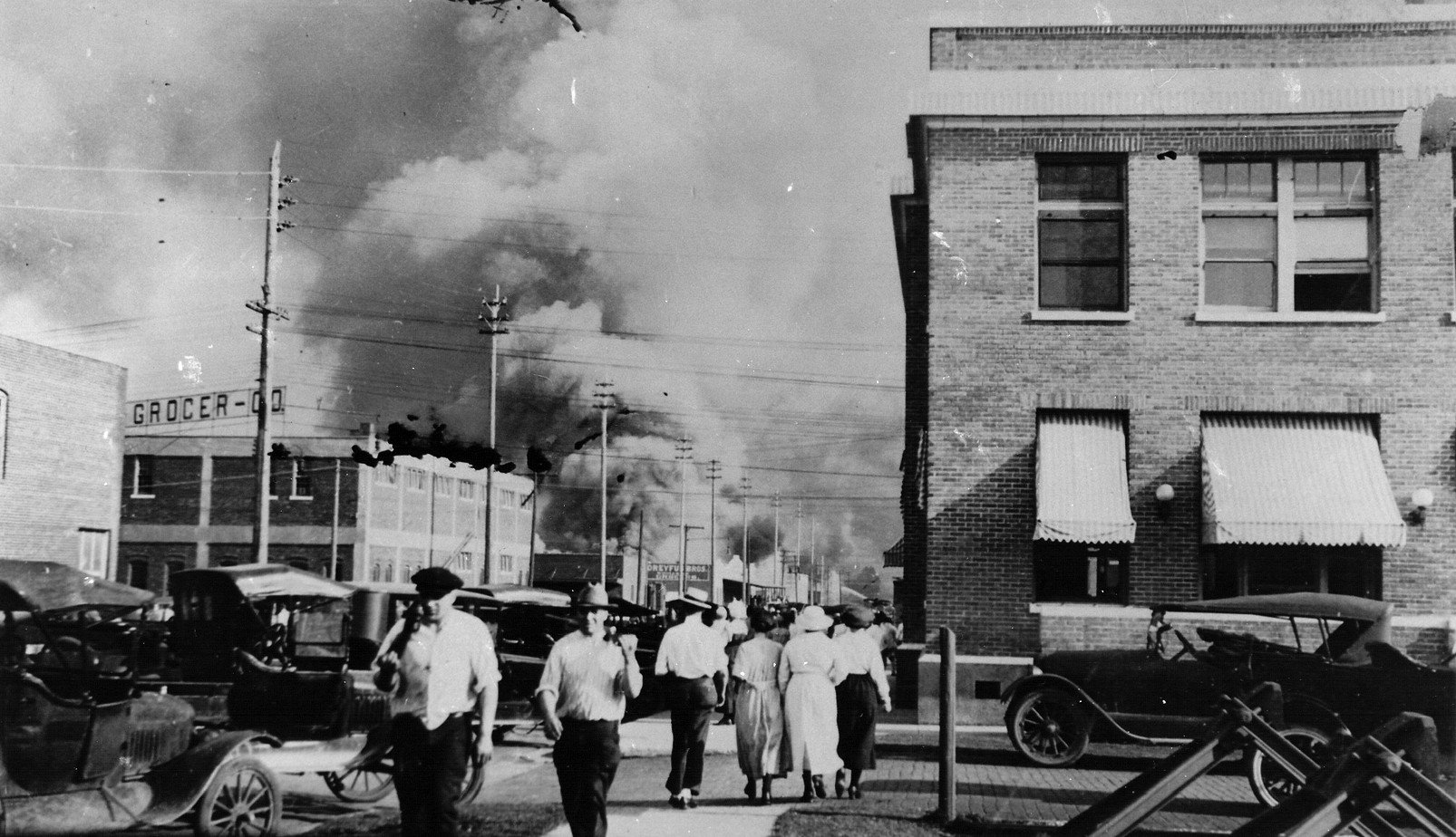 A street in Tulsa with smoke in the distance after the riot.