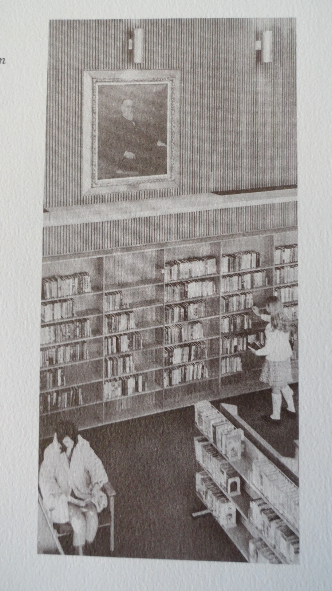Child choosing book in library