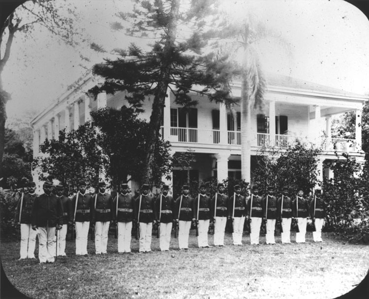 Royal Guards in front of the house of Queen Lili'uokalani (known as Washington Place), circa 1891–93. They were no match for the forces led by U.S. Marines in 1893.