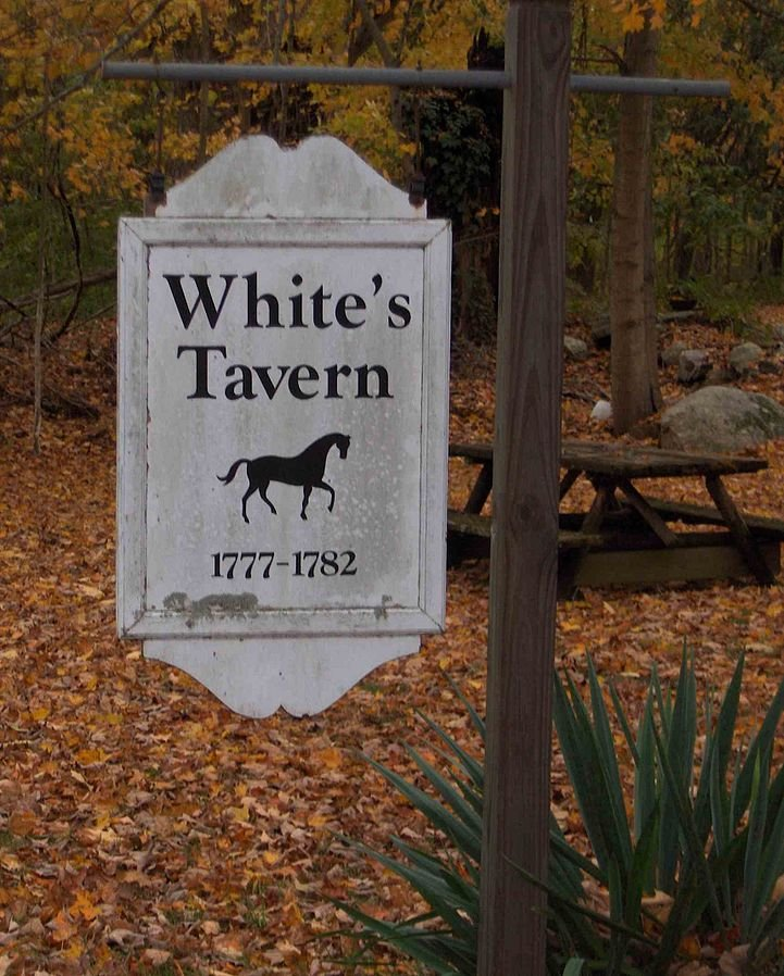 Sign for White's Tavern.