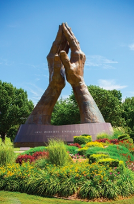 Image of the Praying Hands Statue from Tulsa People.