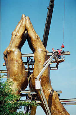 Image of the reconstruction of the Praying Hands Statue during its relocation. Image from Tulsa People.