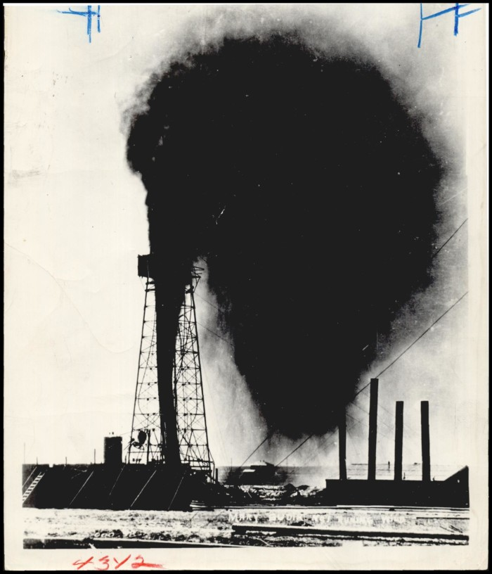"""The ""Wild Mary Sudik"" runs wild in 1930."" Oil well shoots oil in the air."