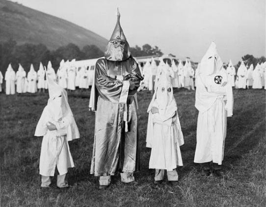 "A picture showing a Ku Klux Klan meeting in Okfuskee County, Oklahoma. It was held in order to recruit new ""knights""."