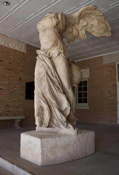 "The ""Winged Victory"" statue located in Old Main's portico was purchased from the Louvre and shipped from Paris in 1982. It will be relocated inside the building in the future lobby of the Institute for Women's Leadership."