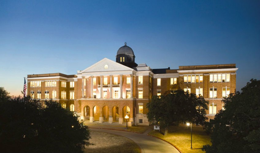 Old Main at dusk. (Source: TWU website)