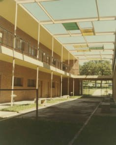 Color photograph showing the panels laid out in checkerboard pattern above the open courtyard circa 1950s. Courtesy of Texas Woman's University.