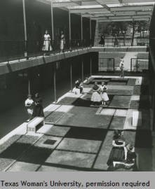 B/W photograph showing the students enjoying the courtyard of the Patio Building circa 1956. Courtesy of Texas Woman's University.