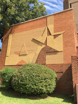 """The """"Star Motif"""" wall of the Patio Building was created by Coreen M. Spellman (Mary), TWU Professor of Art, and faces Oakland Street."""