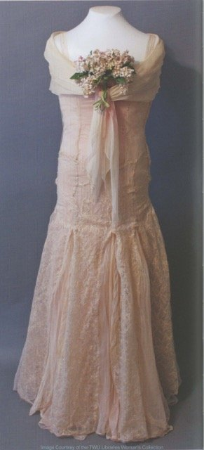 Merle Estelle Butcher O'Daniel (1939-1941) presented her inaugural gown to the collection herself.  It is constructed of pink lace and sheer marquisette with fitted drop waist bodice and flaring skirt. Photo courtesy of the Woman's Collection, TWU.