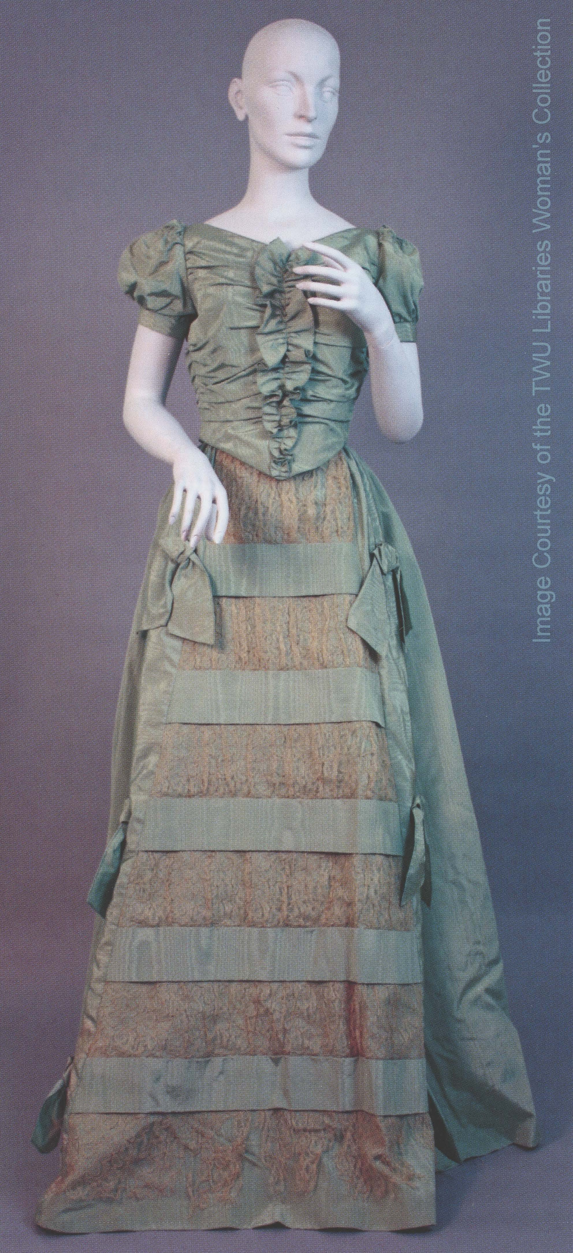 Mary Smith McCrory Jones gown (1844-46) presented to represent the fashion era of her time, and features a tight bodice, puffed sleeves, and full skirt. Photo courtesy of the Woman's Collection, TWU.