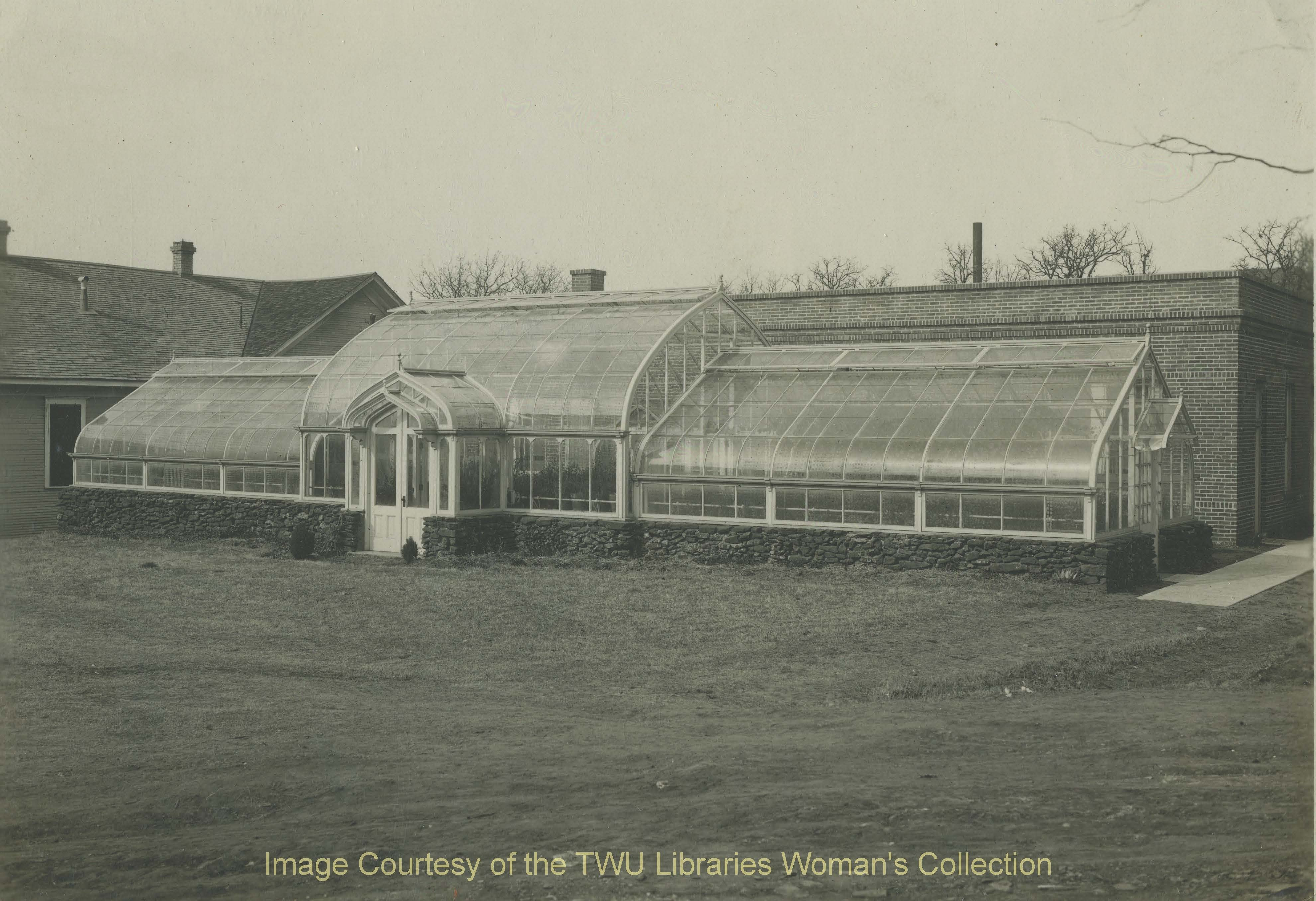 View of the Greenhouse with the Rural Arts Building behind it. (Photo: 1930s, Courtesy of the TWU Woman's Collection)