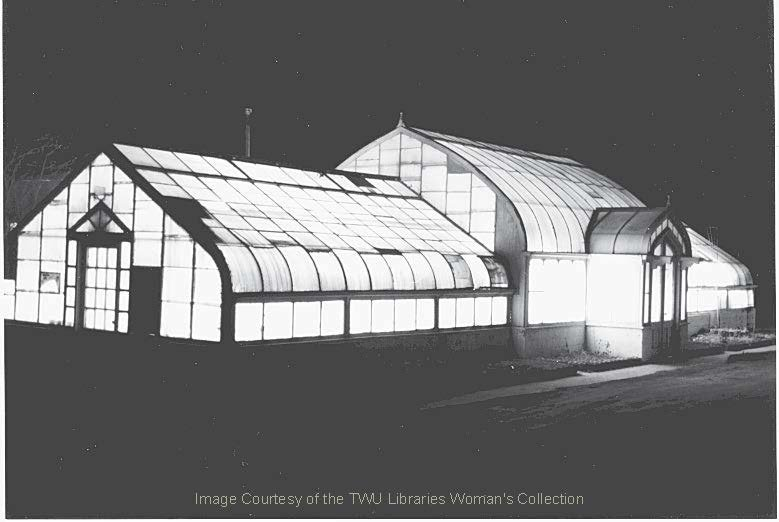 The Greenhouse at night.  This photo was taken in following extensive renovations.  (Photo: 2001, Courtesy of the TWU Woman's Collection)