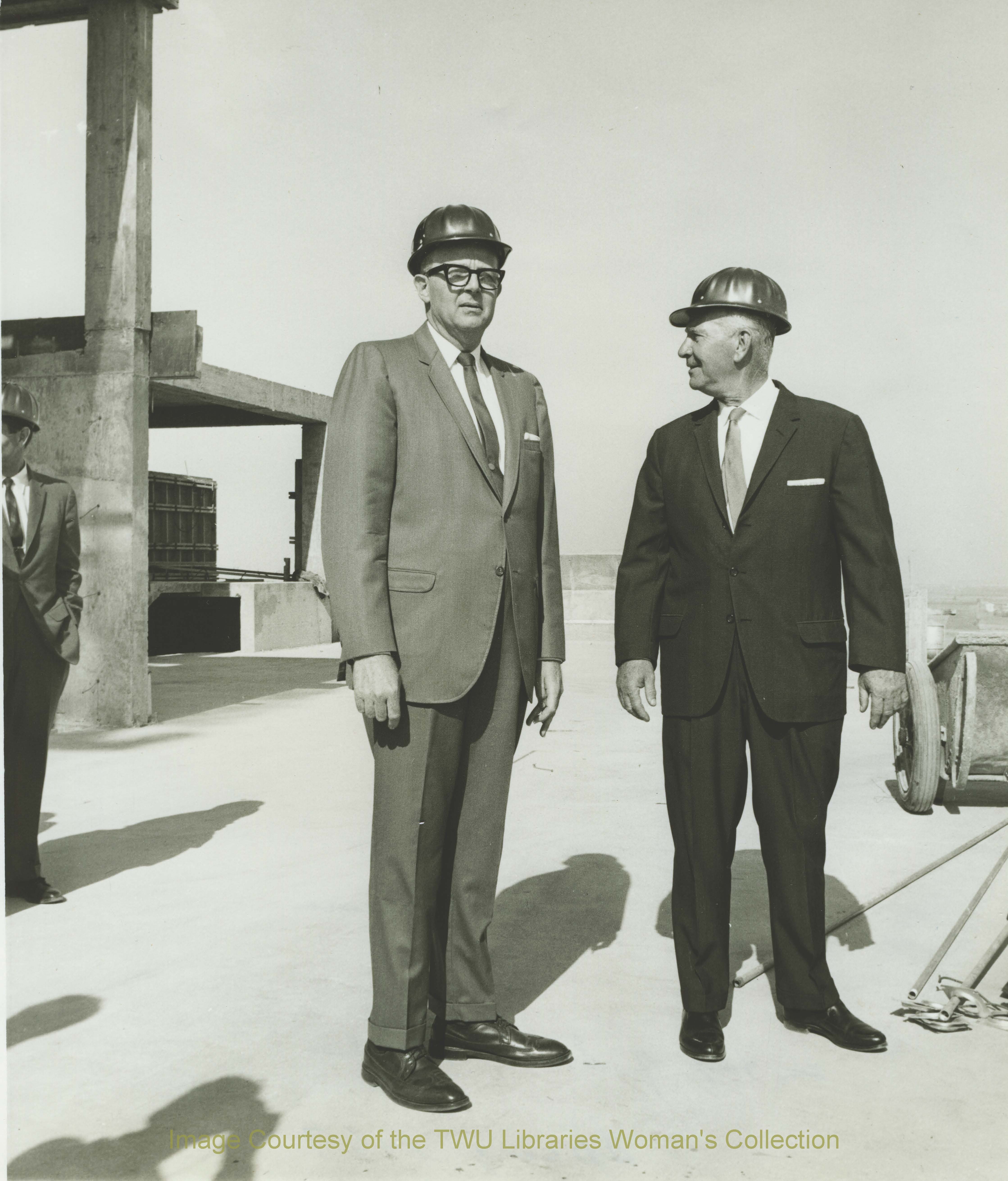 Dr. John A. Guinn and Denton mayor, Warren Whitson on top of Stark Hall during construction, Spring 1967. Courtesy of TWU Libraries.
