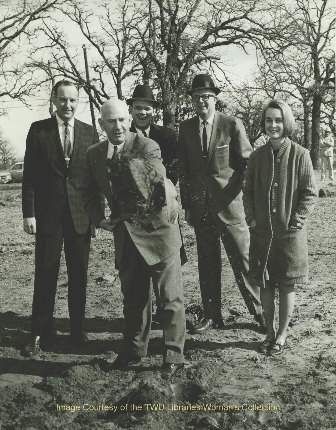 Stark Hall ground breaking ceremony (Jan. 4, 1966). Pictured: Dr. John Guinn, Dr. L.L. Armstrong of Denton First Baptist Church, Bill Drenner of Denton Chamber of Commerce, Mayor Warren Whitson, and TWU student, Paula Rich. Courtesy of TWU Libraries.