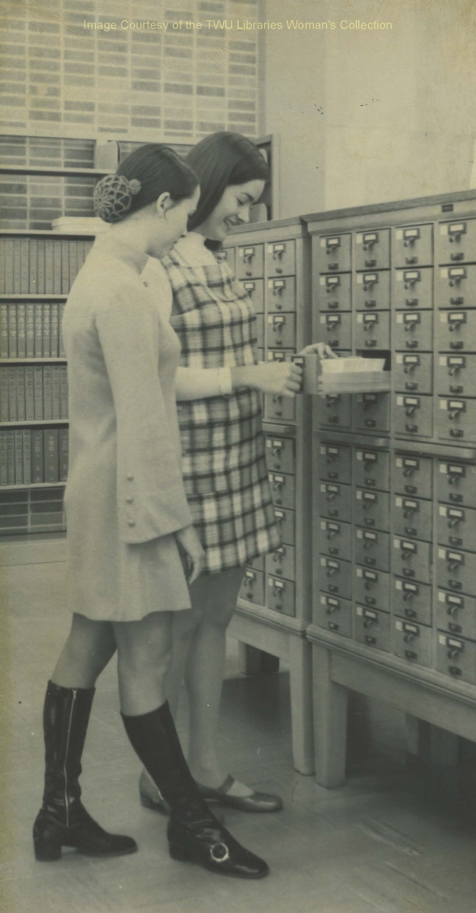 Students browse the card catalog at Bralley Memorial Library. TWU students spent hours sifting through hundreds of cards contained in special file cabinets like the one seen here. (Photo:1960s, Courtesy TWU Woman's Collection)