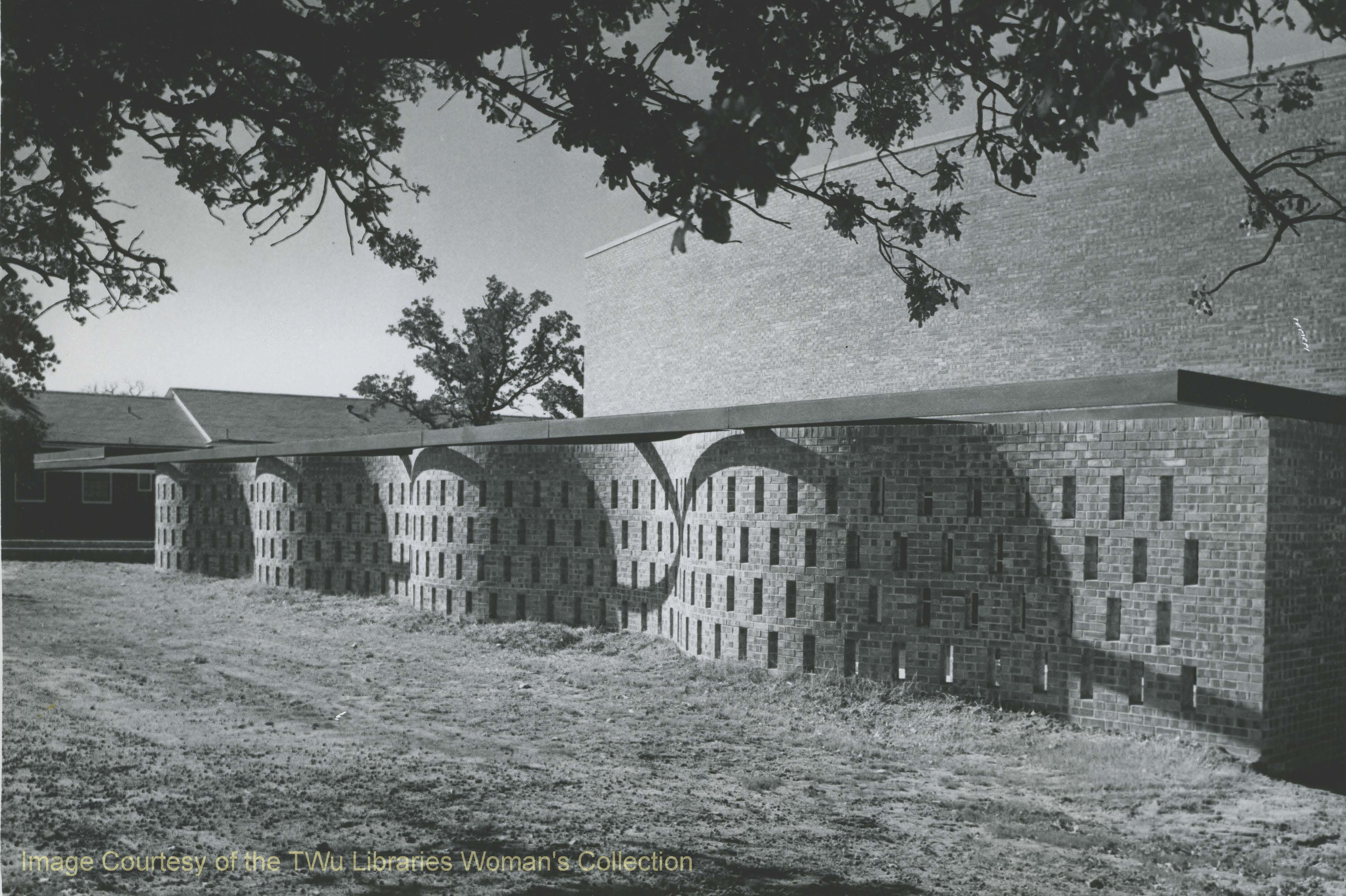 Ribbon Wall located outside the old Redbud Auditorium Building. -Courtesy of TWU archives.