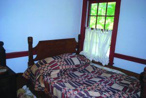 A rope bed in the bedroom of Smith's Tavern