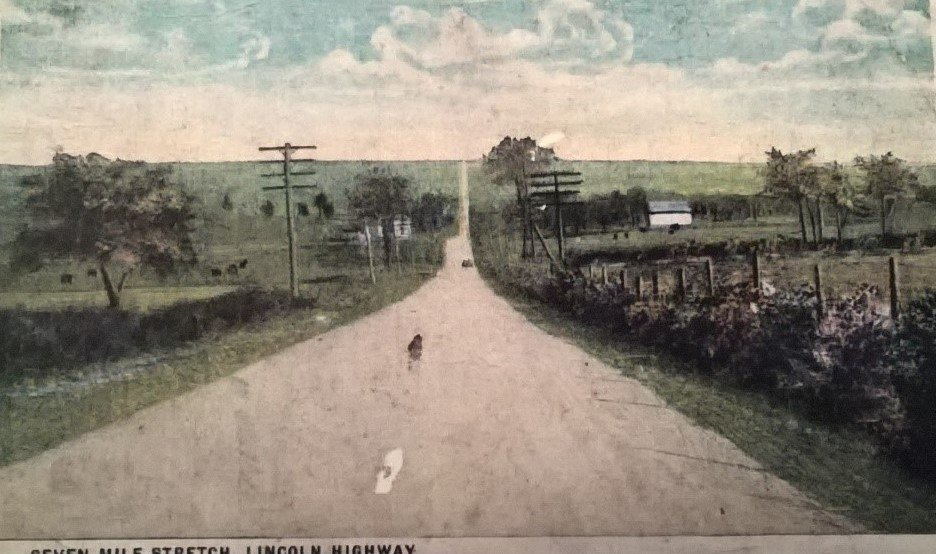 Postcard picturing the Seven Mile Stretch, a famous portion of the Lincoln Highway that leads into Bedford, PA (Lincoln Highway Heritage Corridor Archives).