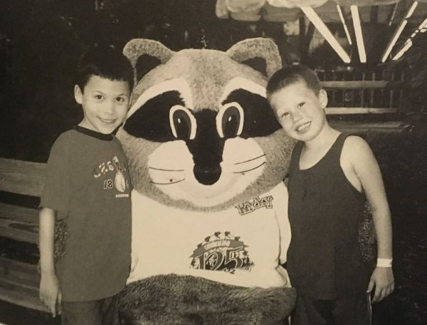 Two park-goers pose with Ricky Raccoon during a visit in 2002. Ricky is the mascot of Raccoon Lagoon, an area of the park dedicated to pint-sized guests.