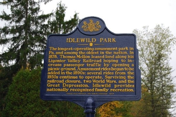 The Pennsylvania historical marker for Idlewild. The park's status as the longest running amusement park in Pennsylvania and the 3rd oldest in the nation helped to earn this distinction.