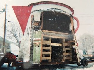 The Coffee Pot in a fragile state being relocated on a truck during a massive snowstorm. The task was seen as very difficult but the job got done.