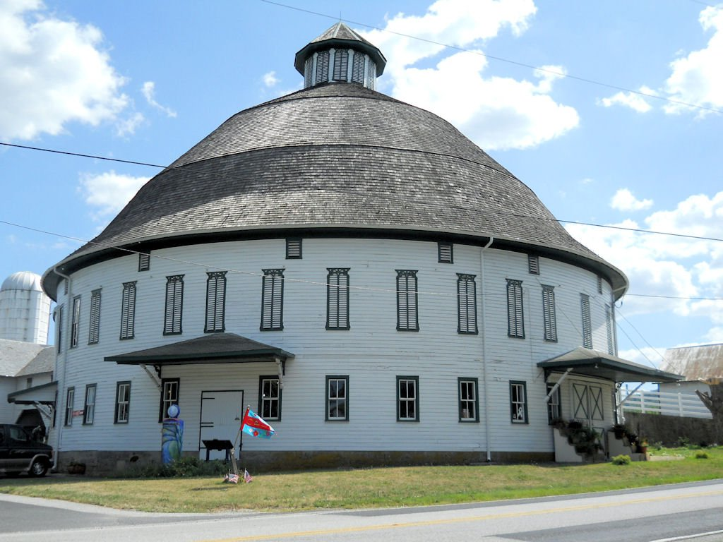 The round barn today is the perfect place to spend an afternoon to browse the shop and see the barn animals. (Roadside Wonders)