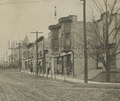 Hurlbutt Building, far right, Milwaukee Avenue looking north from Orchard (Church), 1905-1909
