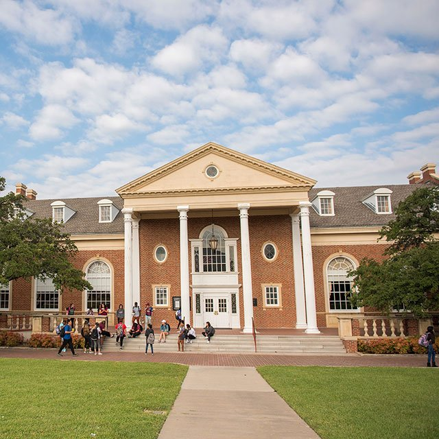Students relaxing on the steps of Hubbard Hall. This picture was taken before the hall went under renovations in January of 2018. (Picture by Texas Woman's University)