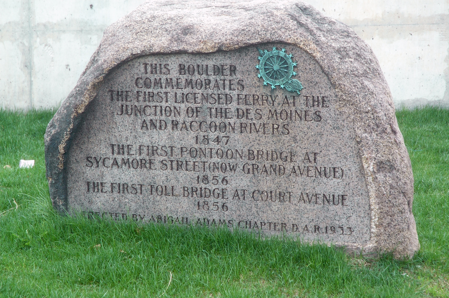 The marker is located next to the Des Moines River adjacent to Grand Avenue.