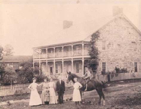 This photo was taken around the later 1800s to the early 1900s.  The women are wearing dresses from that time period while the young boy is riding a horse.  Courtesy of the Jean Bonnet Tavern Website